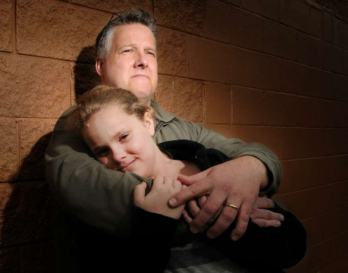 Abby Hardy, 12, and her father Jeff Hardy Saturday 3/17/12. Kathy Hardy,Hardy's wife and Abby's mother, was murdered in a horrific fire at their Branford home. Abby who was only 6 when her mother was murdered now knows many all the details. She wants to know why no one has been arrested in the case. Photo by Peter Hvizdak / New Haven Register