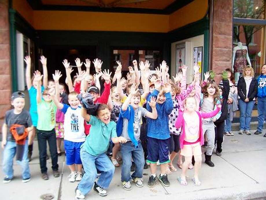 Photo Courtesy HAMILTON THEATER Madison Central School third graders jump for joy outside the Hamilton Theater.