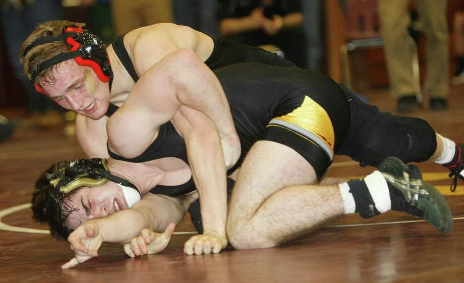 """Dispatch Staff Photo by JOHN HAEGER <a href=""""http://twitter.com/oneidaphtoto"""">twitter.com/oneidaphtoto</a>    J-D/CBA's Aaron Benedict works to score on Canastota's Anthony Finocchiaro in their 138-pound final in the  Canastota Dick New Tournament on Saturday, Jan. 7, 2012 in Canastota. Finocchiaro won the match 6-5 and hopes to lead his team to victory at this weekend's Section III Dual Meet Tournament Championship."""