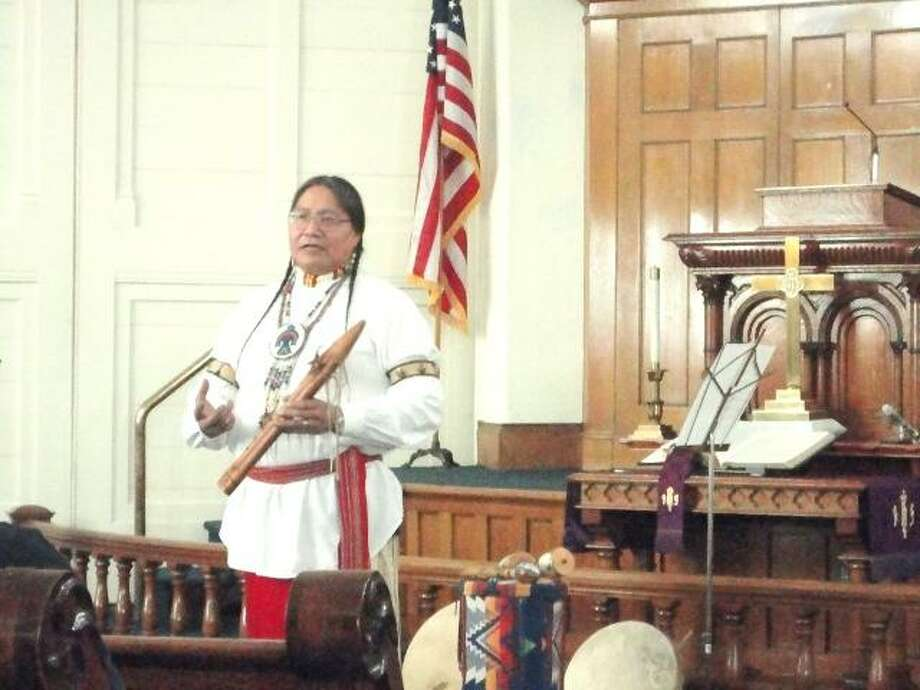 JASON SIEDZIK/ Register Citizen Joseph Fire Crow relayed stories and songs from various traditions, including the Lakota and Cheyenne tribes, during a benefit concert at the Winsted United Methodist Church on Sunday.