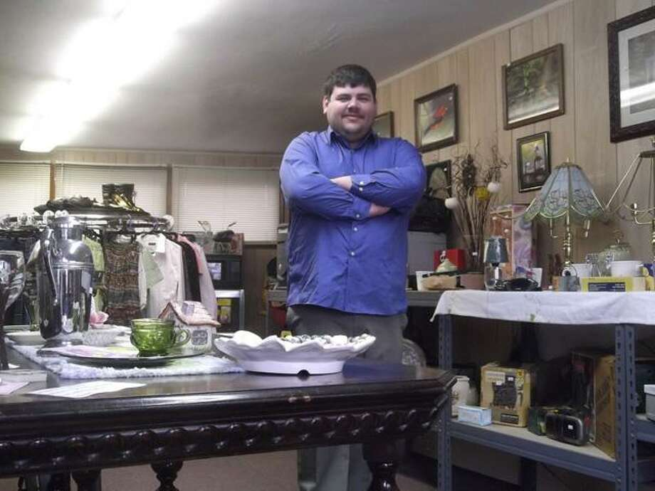 RICKY CAMPBELL/ Register Citizen Down by the River owner Matthew Weik sells an array of new and moderately used items like furniture, clothing, antiques, electronics and more. His shop, at 51 Wall St. in Torrington, opened to the public late last week.