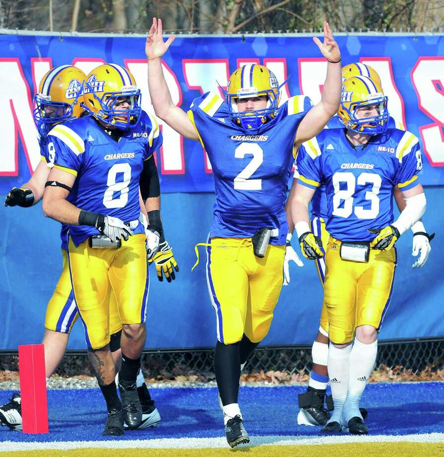 Mike DeCaro (center) of UNH celebrates running a kickoff back for a touchdown in the second half against American International in the Northeast-10 Championship in West Haven on 11/10/2012.Photo by Arnold Gold/New Haven Register