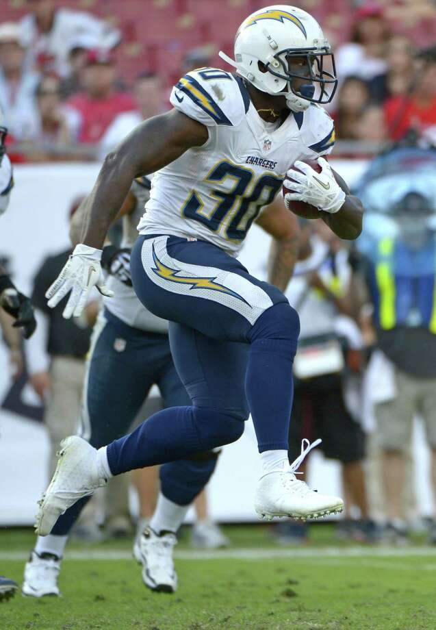 San Diego Chargers running back Ronnie Brown (30) runs for yardage during the second half of an NFL football game against the Tampa Bay Buccaneers in Tampa, Fla., Sunday, Nov. 11, 2012.(AP Photo/Phelan M. Ebenhack) Photo: AP / FR121174 AP