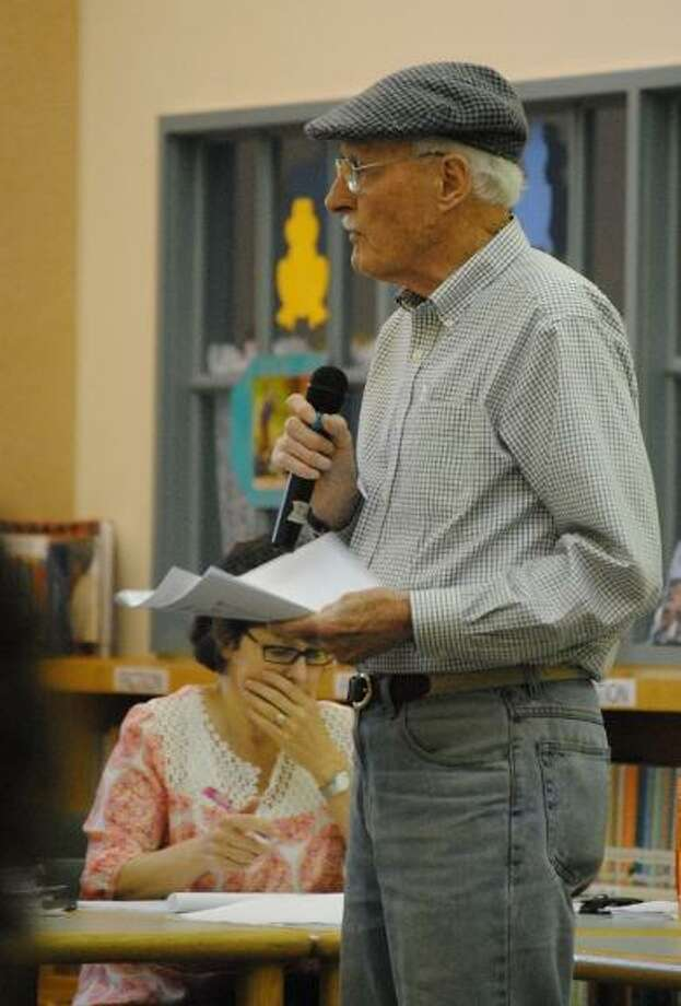 William Moran addresses the Torrington Board of Education at its budget public hearing Monday night at Vogel-Wetmore Elementary School. (MIKE AGOGLIATI / Register Citizen)