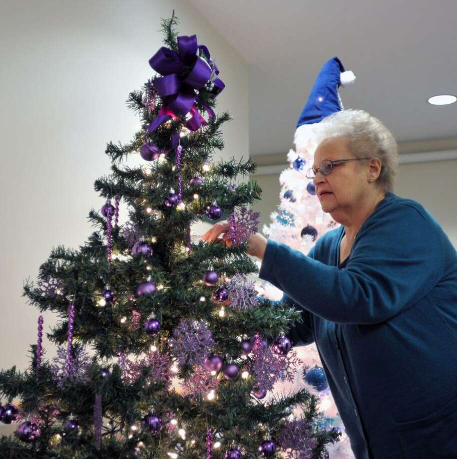 """Shelton-- Penny Tuminski puts the finishing touches on a tree at the """"Festival of Trees and Crafts Fair"""" at Wesley Heights in Shelton. The 9th annual event runs Sat and Sun at the senior housing complex in Shelton. Tumiski was helping her daughter, owner of A&D Diamonds (in Monroe), who was putting up one of the 37 trees. Photo--Peter Casolino/New Haven Register. 11/15/12                Shelton-- Penny Tuminski puts the finishing touches on a tree at the """"Festival of Trees and Crafts Fair"""" at Wesley Heights in Shelton. The 9th annual event runs Sat and Sun at the senior housing complex in Shelton. Tumiski was helping her daughter, owner of A&D Diamonds (in Monroe), who was putting up one of the 37 trees. Photo--Peter Casolino/New Haven Register."""