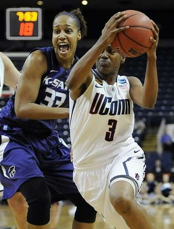 Connecticut's Tiffany Hayes (3) drives to the basket while guarded by Kansas State's Jalana Childs during the first half of an NCAA tournament second-round college basketball game in Bridgeport, Conn., Monday, March 19, 2012. (AP Photo/Jessica Hill) Photo: ASSOCIATED PRESS / AP2012