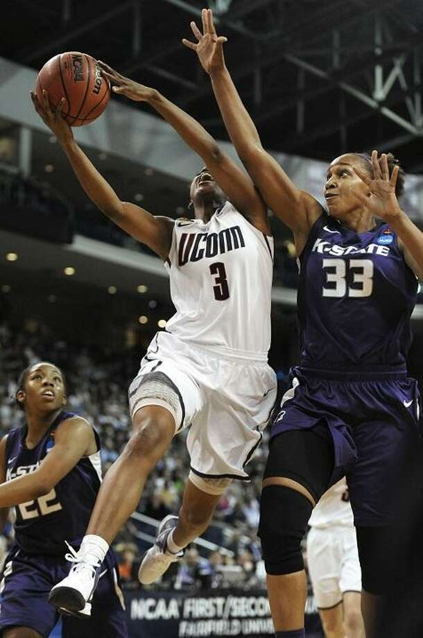 Kansas State's Jalana Childs (33) fouls Connecticut's Tiffany Hayes during the first half of an NCAA tournament second-round college basketball game in Bridgeport, Conn., Monday, March 19, 2012. (AP Photo/Jessica Hill) Photo: ASSOCIATED PRESS / AP2012