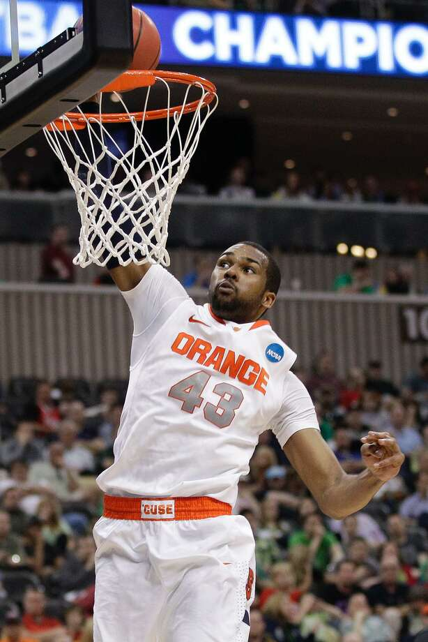 Syracuse's James Southerland (43) dunks late in a 75-59 win over Kansas State in an NCAA tournament third-round college basketball game in Pittsburgh, Saturday, March 17, 2012. ( AP Photo/Gene J. Puskar) Photo: ASSOCIATED PRESS / AP2012
