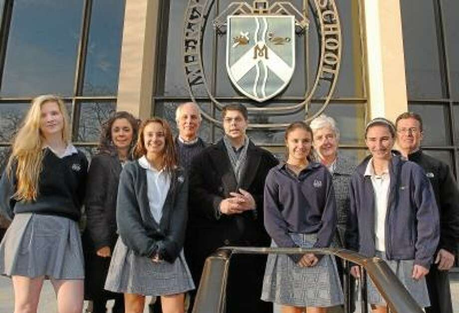 Catherine Avalone/The Middletown Press Students of Mercy, Middletown and Xavier High School will collect non-perishable food items for Amazing Grace Food Pantry during the annual Thanksgiving Day football game between Xavier and Middletown. During a press conference on Friday, Mayor Dan Drew announced details of the event with Sister Mary McCarthy, President of Mercy High School, Ron Krom, Director of St.Vincent DePaul Middletown, members of the junior class Maura Eckels, Stephanie Case, Alyssa Case and Alexandra Zampini and Christina and Mike Case of the Mercy Home & School Association.