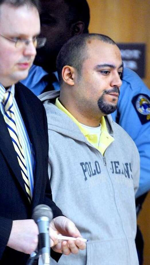 Angel Luis Santiago, right, is arraigned in December 2011 at Superior Court in Derby. Arnold Gold/Register file photo