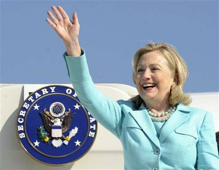 In this 2011 file photo, Secretary of State Hillary Rodham Clinton waves as the arrives at Lusaka International Airport in Lusaka, Zambia. If diplomatic achievements were measured by the number of countries visited, Hillary Rodham Clinton would be the most accomplished secretary of state in history. Since becoming secretary of state in 2009, Clinton has logged 351 days on the road, traveled to 102 countries and flown a whopping 843,839 miles, according to the State Department.  Associated Press Photo: ASSOCIATED PRESS / A2011