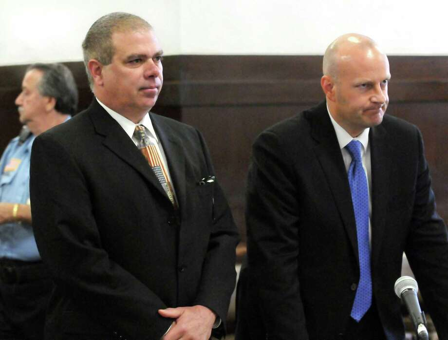 Retired East Haven Police Officer Michael D'Amato left and his lawyer Gregory Cerritelli appear in New Haven Superior Court. D'Amato allegedly stole $1300 from an evidence locker. Mara Lavitt/New Haven Register5/17/12