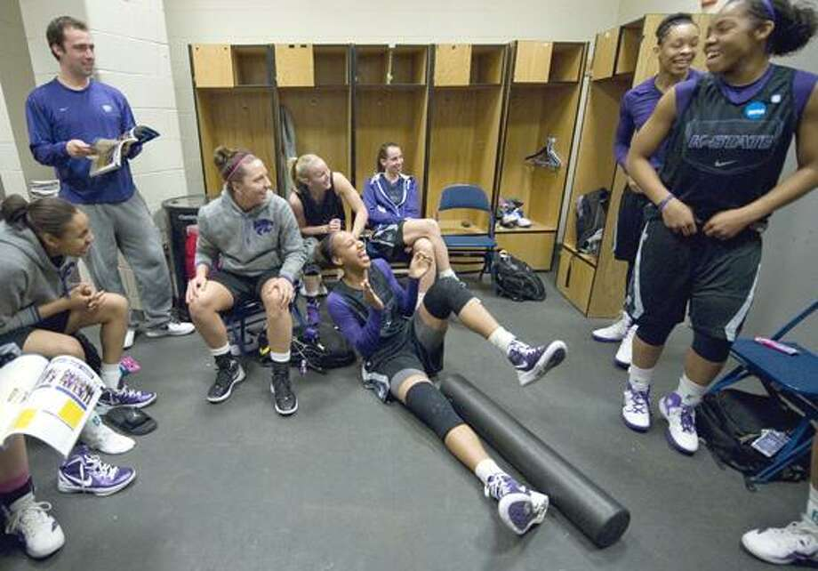Kasas State players relax in their locker room before practice in Bridgeport, Conn., Sunday, March 18, 2012. Kansas State is scheduled to face Connecticut in a second-round game on Monday. (AP Photo/Jessica Hill) Photo: AP / AP2012