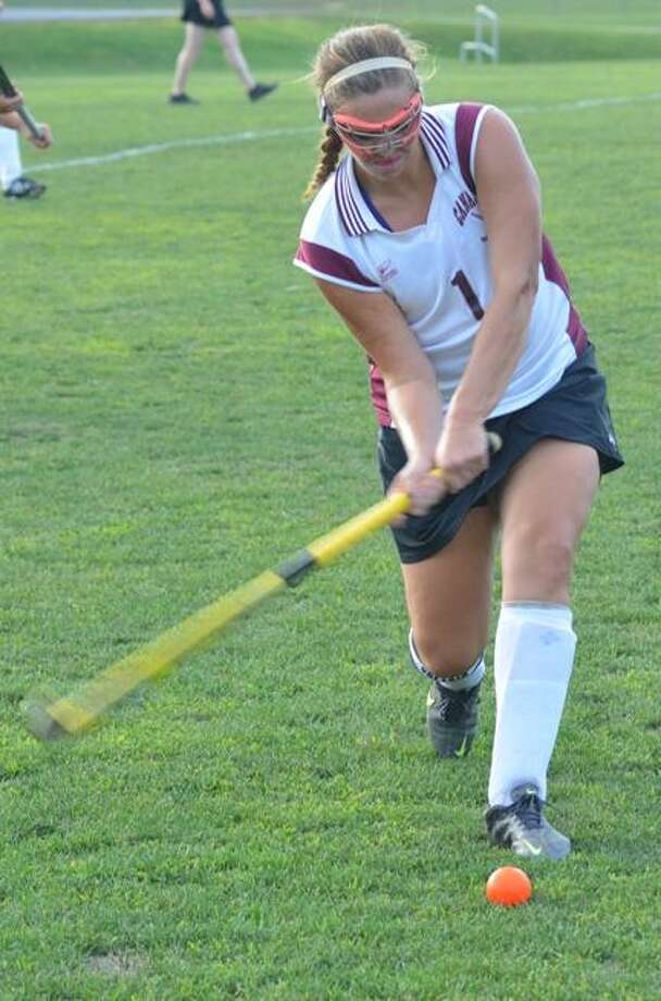 Dispatch Staff Photo by KYLE MENNIGCanastota's Shea Foster hits the ball during a field hockey game against Holland Patent on Monday, Sept. 17, 2012.