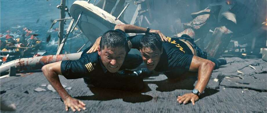 "Universal Pictures photo: Tadanobu Asano, left, and Taylor Kitsch earn hazard duty pay for their roles in ""Battleship."" Photo: ASSOCIATED PRESS / AP2012"