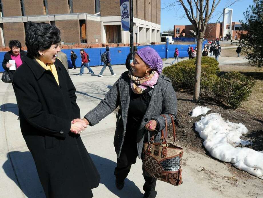 The new Southern Connecticut State University President Mary Papazian is greeted and welcomed by student Judith Jarrett-Smith of New Haven as Papazian walks across campus to an appointment. Photo by Mara Lavitt/New Haven Register