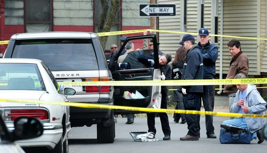 New Haven Police investigate a shooting at the corner of Munson and County St. in New Haven on 3/17/2012.  In center of group at right facing camera is Police Chief Dean Esserman.Photo by Arnold Gold/New Haven Register   AG0443E