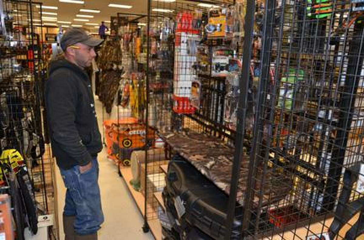 Dispatch Staff Photo by KYLE MENNIG Josh Ashcraft of North Norwich shops for hunting supplies at Herb Philipson's in Oneida on Thursday. Thousands of hunters will set out Saturday morning for the opening of the southern zone deer season.