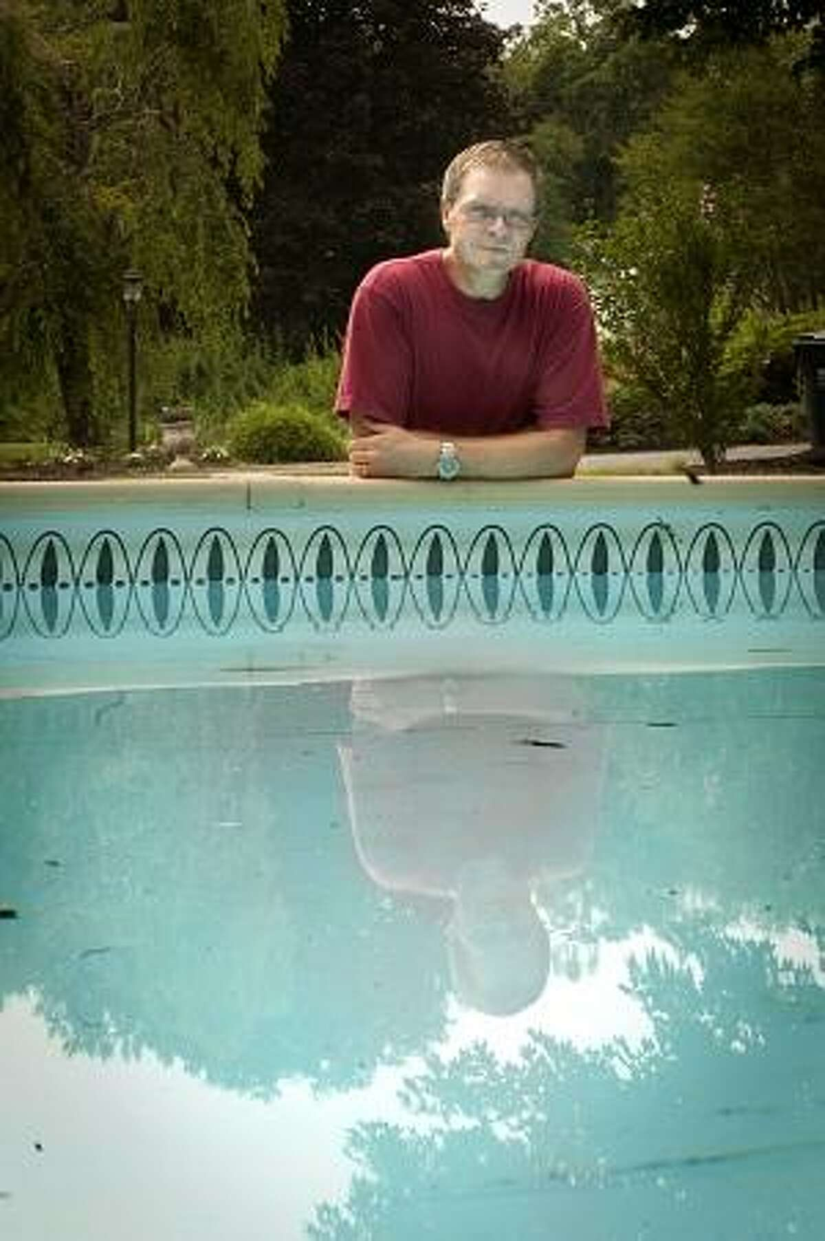 Brookfield-Steve Kohlase, of Brookfield, by his swimming pool. He says the water sometimes ripples from vibrations caused by gas pipelines Melanie Stengel/Register