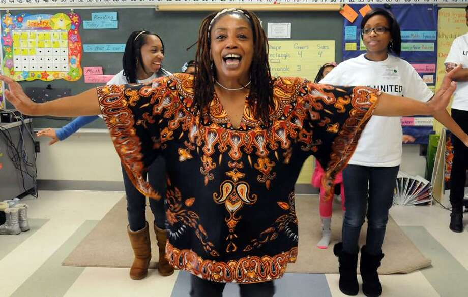 Shari Caldwell teaches African dance steps during the  Character Over Color Conference at Wexler-Grant Community School in New Haven. Melanie Stengel/Register