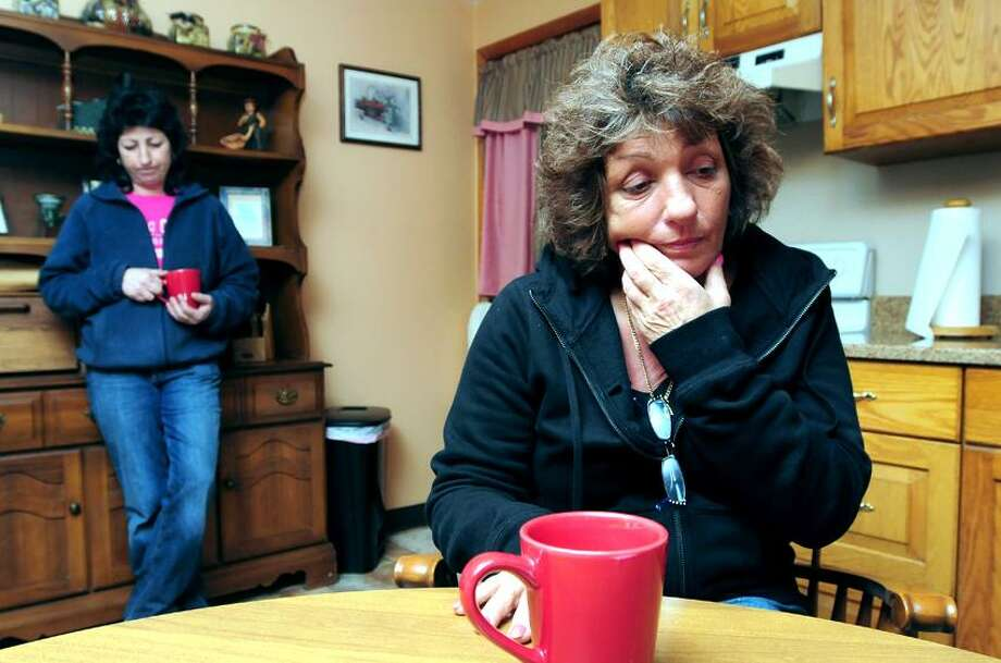 Donna Lee, right, talks about the disappearance of her daughter, Doreen Vincent, in 1988 at her home in Waterbury recently. At left is her sister, Debbie Pereira. Arnold Gold/Register