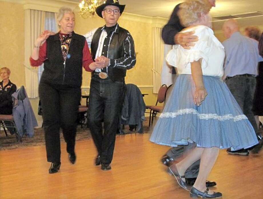 """DEBBI MORELLO/ The Register Citizen Dick Shokite and Barbara Babiyan are doing a """"couples promenade,"""" a square move, at an afternoon of country western dancing at the Cornucopia Hall on Sunday afternoon."""