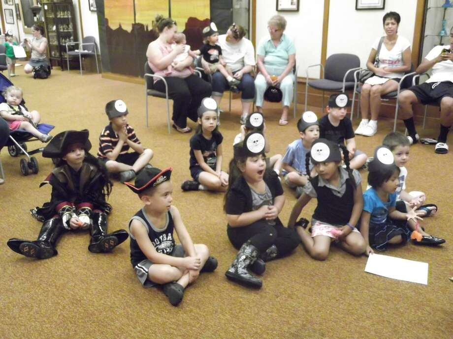 MICHELLE MERLIN/Register Citizen Children ages 3 to 5 dressed up as pirates for a visit to the Torrington Library Friday morning.