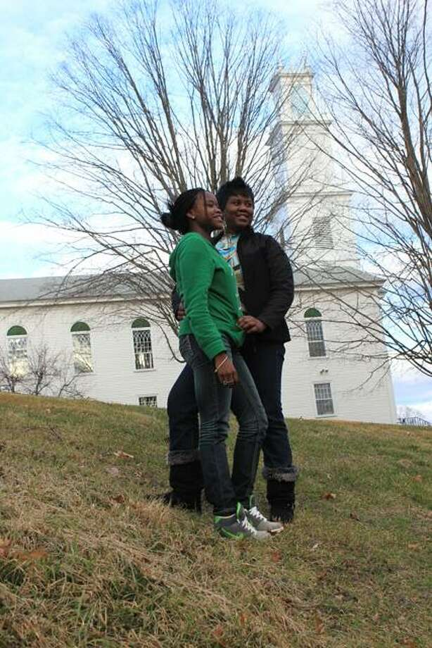 Photo by Clennon L. King  Simsbury High School junior Damali Scipio, 16, stands with her mother, Corrine Wilson in front of First Church of Christ Congregational, which King attended in 1944.