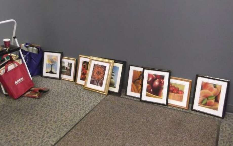 Part of the process - deciding what to hang where. (photo by Jenny Golfin/Register Citizen)