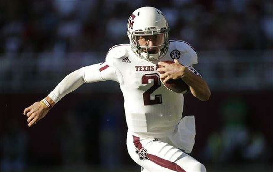 Texas A&M quarterback Johnny Manziel (2) runs for a first down during the first half of an NCAA college football game against Alabama at Bryant-Denny Stadium in Tuscaloosa, Ala., Saturday, Nov. 10, 2012. (AP Photo/Dave Martin) Photo: ASSOCIATED PRESS / AP2012