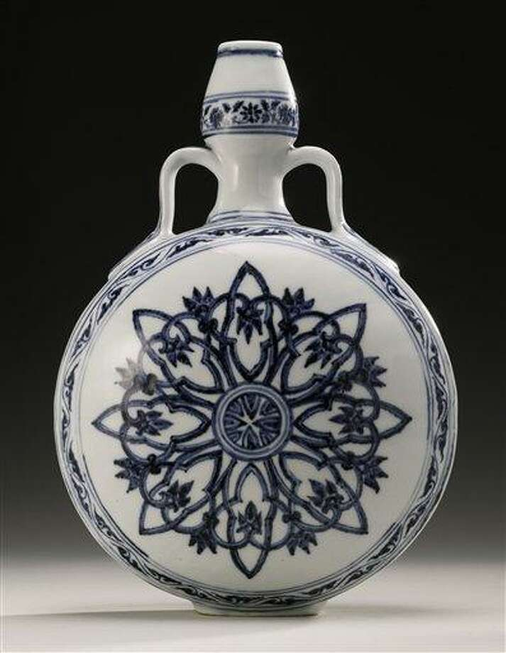 This undated photo provided by Sotheby's shows a rare Ming Dynasty vase that had been used as a doorstop in a Long Island home. The blue and white moonflask was auctioned Wednesday, Sept. 12, 2012 at Sotheby's New York sale of Chinese works of art, fetching $1.3 million. (AP Photo/Sotheby's) Photo: AP / Sotheby's
