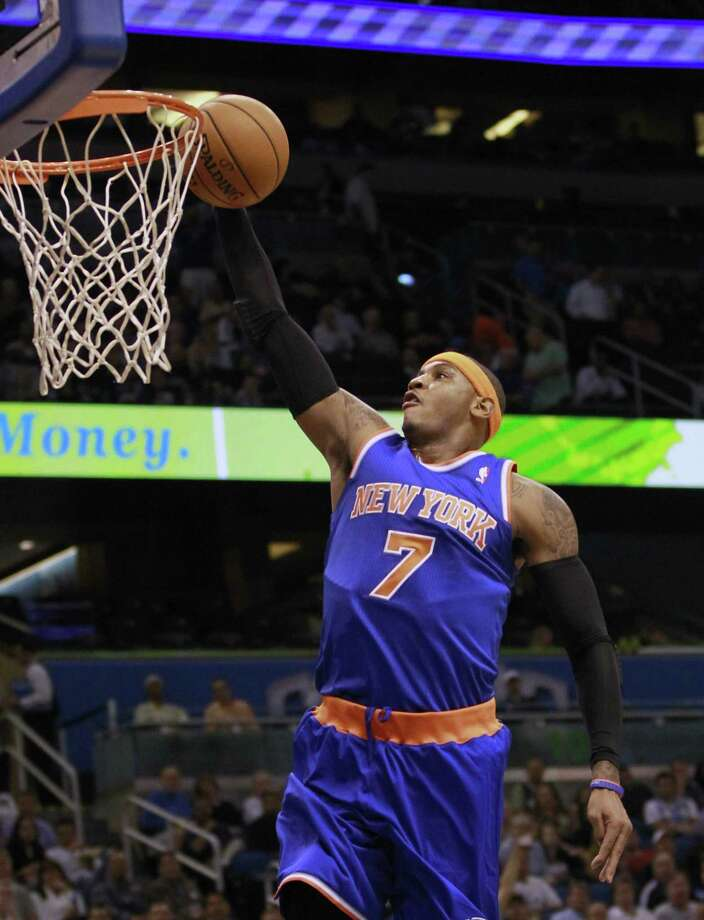 New York Knicks' Carmelo Anthony makes an uncontested shot off of a fast break against the Orlando Magic during the first half of an NBA basketball game, Tuesday, Nov. 13, 2012, in Orlando, Fla. (AP Photo/John Raoux) Photo: AP / AP2012