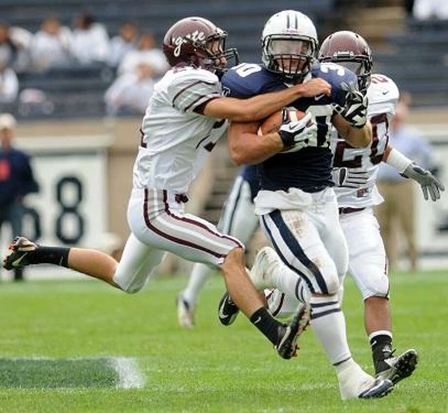 Colgate defensive back Demitri Diamond tries to bring down Tyler Varga of Yale University  during first quarter football action at the Yale Bowl in New Haven, Conn. Saturday, September 29, 2012.  Photo by Peter Hvizdak / New Haven Register Photo: New Haven Register / ©Peter Hvizdak /  New Haven Register