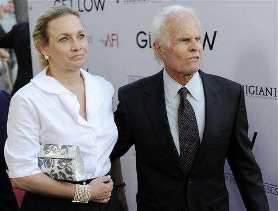 """FILE - In this July 27, 2010 file photo, producer, Richard Zanuck, and his wife Lili Fini Zanuck arrive at the premiere of the film """"Get Low"""" in Beverly Hills, Calif. According to his publicist, Richard D. Zanuck has died at age 77 in Los Angeles on Friday, July 13, 2012. He won an Oscar for best picture for his film, """"Driving Miss Daisy."""" (AP Photo/Chris Pizzello, File) Photo: ASSOCIATED PRESS / A2010"""