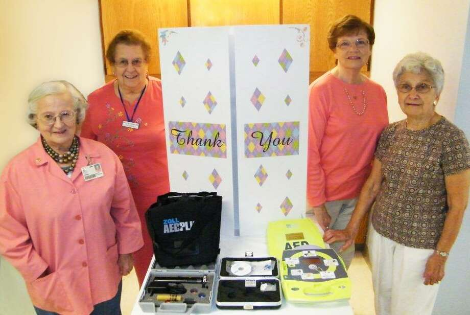 Volunteers of Winstedís Auxiliary For Community Health, from left, are Gemma DiMauro, Rosemary Surdan, President Millie Hudak, and Helen Dombrowski, with equipment purchased with their donated funds at CHH Emergency and Medical Care in Winsted.