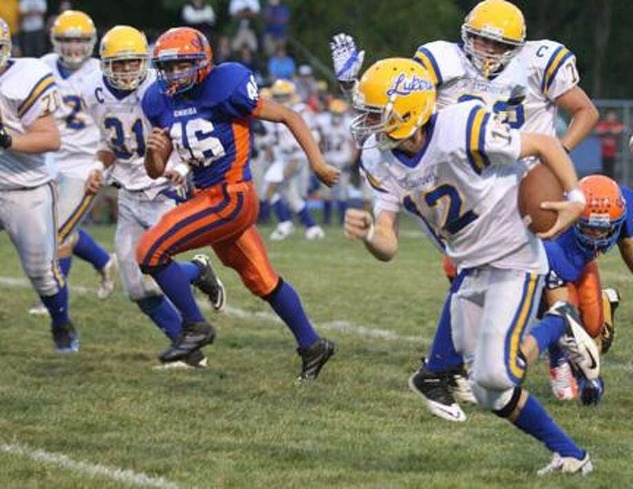 Dispatch Staff Photo by JOHN HAEGER (Twitter.com/OneidaPhoto)Cazenovia's quarterback Alex Sullivan (12) runs for a first down against Oneida in the first half of their game in Oneida on Friday, Sept. 14, 2012.
