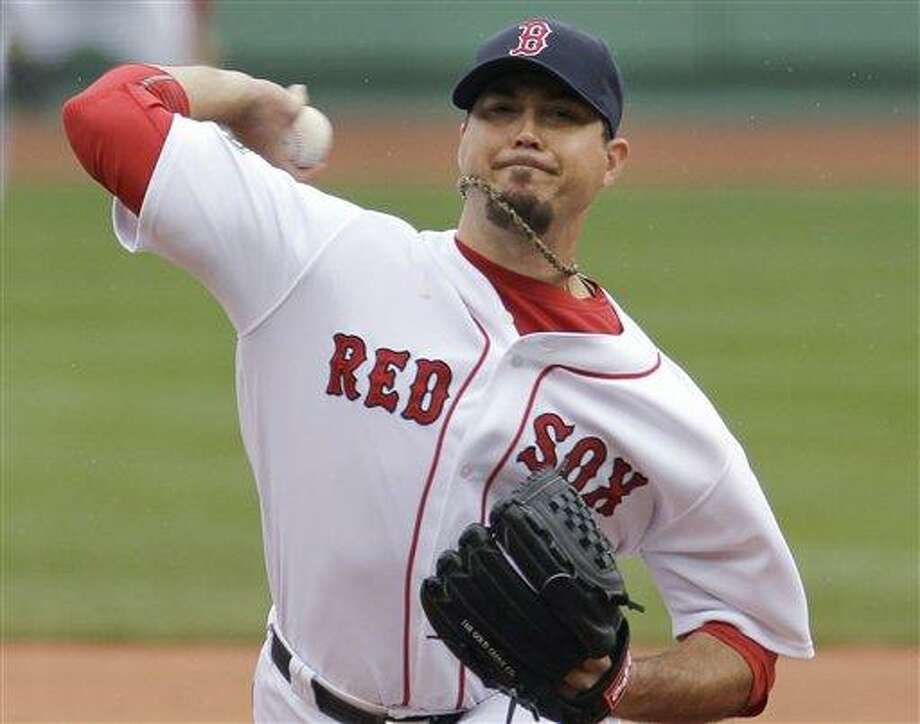 Boston Red Sox starting pitcher Josh Beckett delivers to the Seattle Mariners in the first inning of a baseball game at Fenway Park in Boston, Tuesday, May 15, 2012. The Red Sox won 5-0. (AP Photo/Elise Amendola) Photo: ASSOCIATED PRESS / AP2012