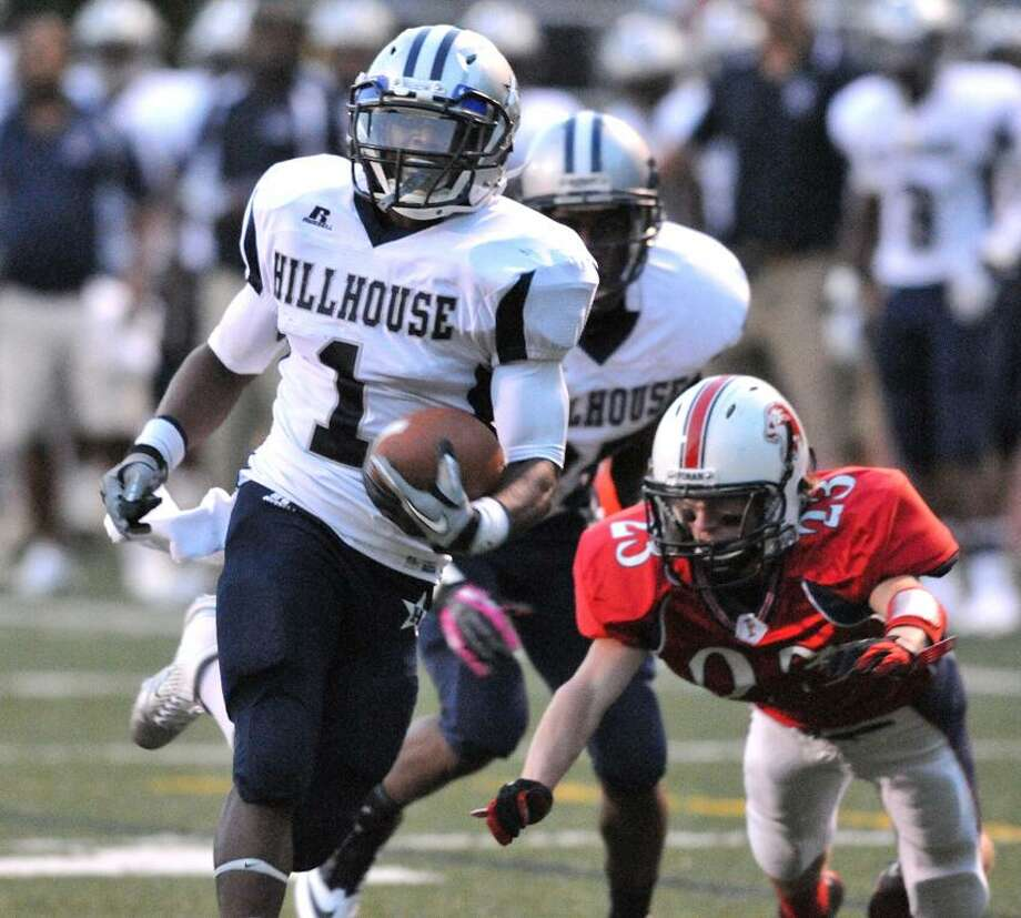 New Haven-- Hillhouse's Harold Cooper runs for his first TD of the night against Foran during the first quarter. Photo Peter Casolino/New Haven Register 09/12/2012