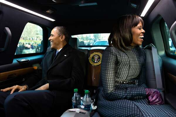President Barack Obama and First Lady Michelle Obama ride in the inaugural parade in Washington, D.C., Jan. 21, 2013.