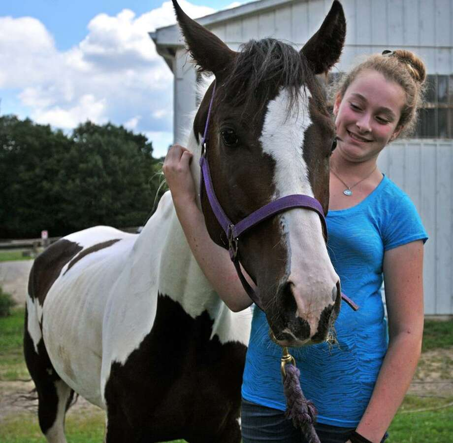 """Isabella Feder, 12, of North Branford has donated her allowance to help """"Cheyenne,"""" the now famous horse who is recovering at Lockets Meadow Farm. Peter Casolino/New Haven Register"""