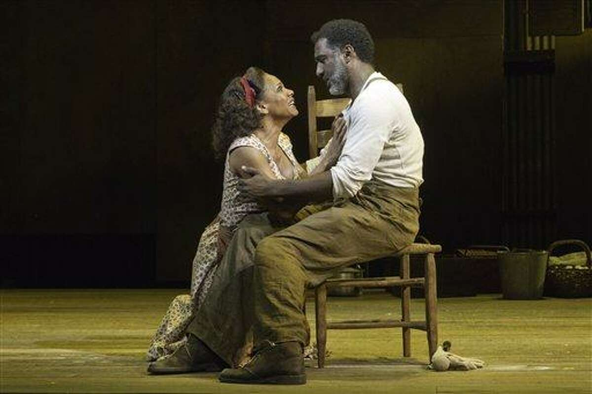 """In this theater image released by Jeffrey Richards Associates, Audra McDonald, left, and Norm Lewis are shown in a scene from """"The Gershwins' Porgy and Bess"""" in New York. (AP Photo/Jeffrey Richards Associates, Michael J. Lutch)"""
