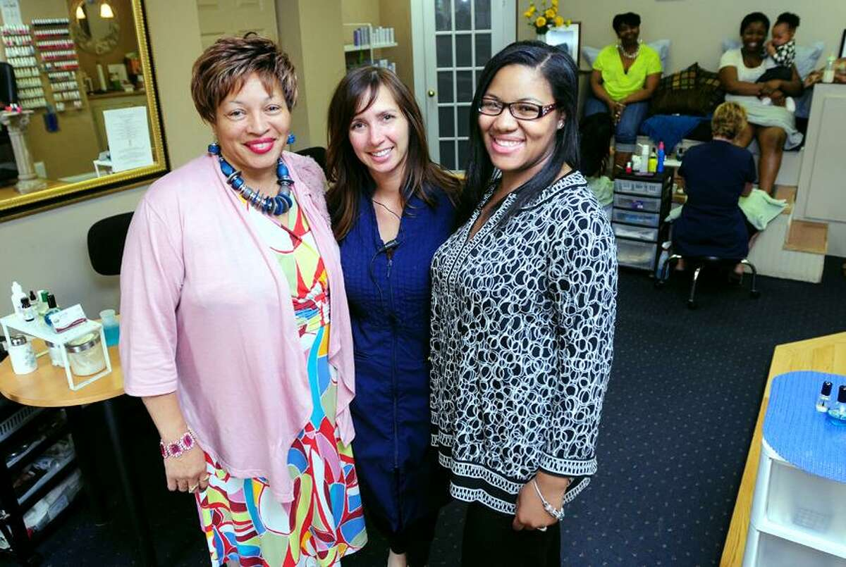 Pamela Monk Kelley (left) is photographed with her daughter, LaShante James (right) and Sheila Bonanno (center), owner of the Joiya Day Spa & Hair Designs, in Hamden on 5/11/2012.Photo by Arnold Gold/New Haven Register AG0448E