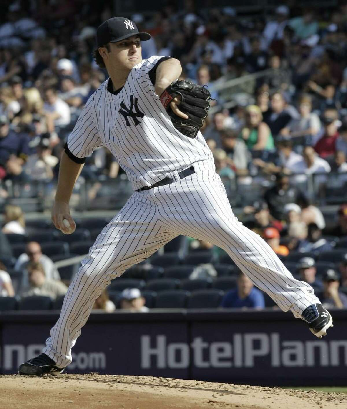 ASSOCIATED PRESS New York Yankees pitcher Phil Hughes throws in the third inning of Saturday's game against the Seattle Mariners at Yankee Stadium in New York. The Yankees won 6-2.