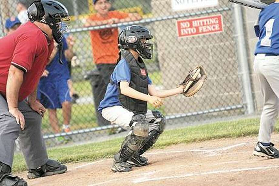 Photo courtesy AMY BECKEROneida Little League 9-10 Baseball All-Star catcher Ty D'Arcangelis, 10, catches a pitch in Oneida's 8-3 victory over Camden on June 28.