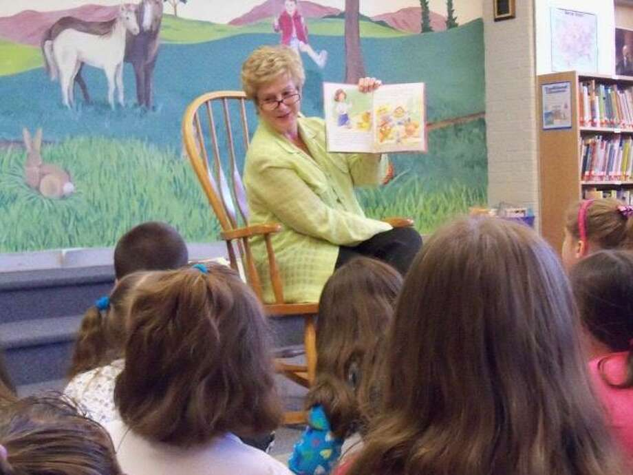 Former Connecticut Gov. M. Jodi Rell reads a story to students at Thomaston's Black Rock School during her visit May 7.
