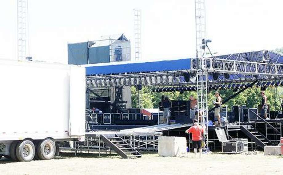 Photo by JOHN HAEGER (Twitter.com/OneidaPhoto)  Crews work to construct the stage for Country Jam  on Wednesday July 11, 2012 in Bouckville.