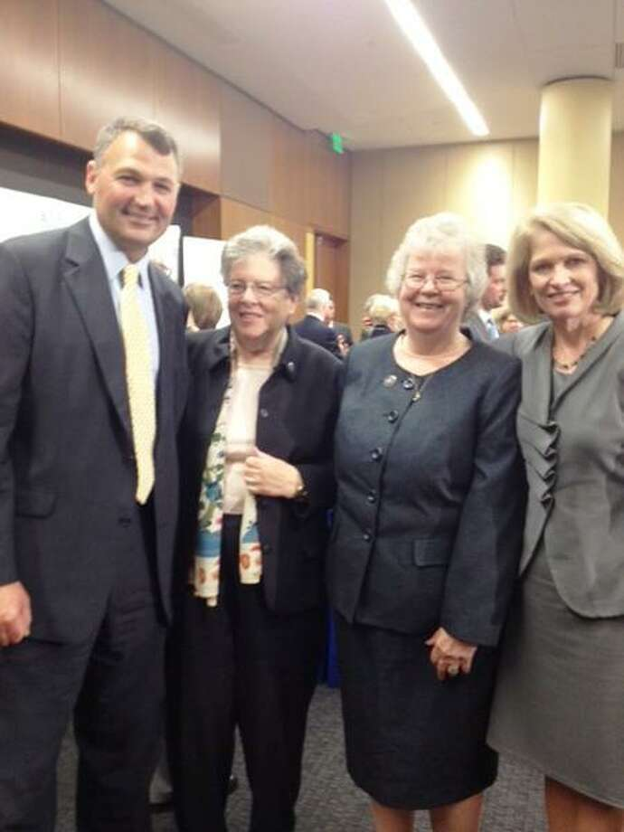 From left to right, Christopher O'Connor, the newly appointed chief operating officer of Yale New Haven Health System and the former president and CEO of Saint Raphael Healthcare System; Sister Rosemary Moynihan, general superior of the Sisters of Charity of Saint Elizabeth; Sister Maureen Shaughnessy, the former general superior and d Marna Borgstrom, chief executive officer of Yale-New Haven Hospital and president and CEO, Yale New Haven Health System. They all attended the signing ceremony Tuesday where the two hospitals will merge as of 12:01 a.m. Wednesday. It will be the largest hospital in the state and among the 10 largest in the country.