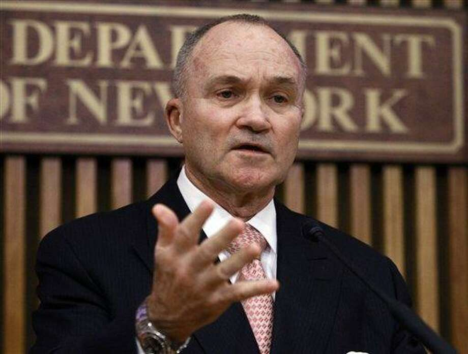 In a February file photo, New York Police Commissioner Ray Kelly responds to questions during a news conference in New York. A Quinnipiac University poll released Tuesday says 82 percent of respondents thought the NYPD has been effective in combatting terrorism. The new poll says more than 80 percent of city voters think the New York Police Department fights against terrorism effectively and a majority of voters say the police act appropriately with Muslims.   Associated Press Photo: AP / AP2012
