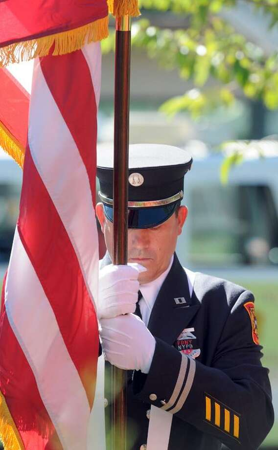 Milford Fire Capt. Ron Wetmore during a 9/11 remembrance at the World Trade Center Memorial Garden, Live Oaks Elementary School in Milford.  Mara Lavitt/New Haven Register