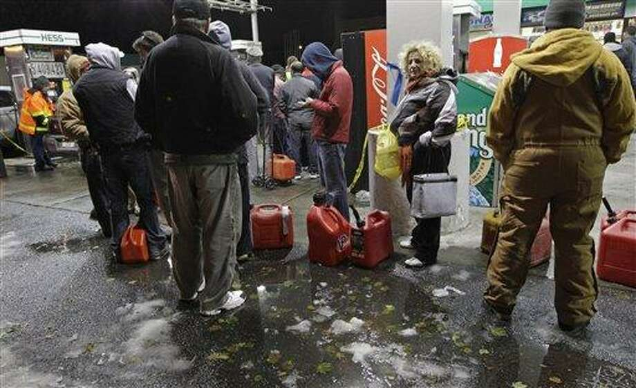 People wait in line for gasoline at a Hess station in Brooklyn Thursday where gas is still scarce in New York. Fuel shortages and distribution delays that led to gas hoarding have prompted New York City and Long Island to initiate an even-odd gas rationing plan which begins Friday at 6 a.m. in New York and 5 a.m. in Long Island. Associated Press Photo: AP / AP